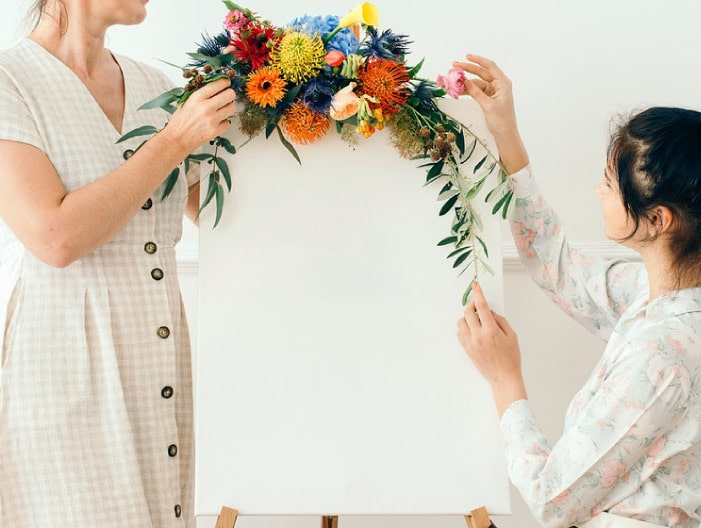 Ladies decorating room with flowers
